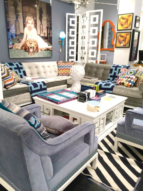 gorgeous blue gray walls and jonathan adler living room