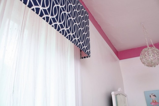 PHOEBE'S BEDROOM WITH PINK LADIES AOBVE THE PICTURE RAIL