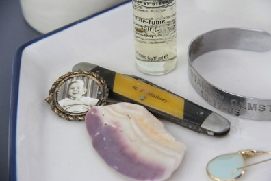 a pocket knife from my grandpas cement company, a photo of my dad as a toddler, a sea shell from the beach, my Vietnam MIA bracelet ...all treasures