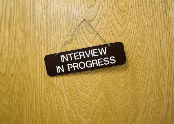 "A door sign saying ""interview in progress"""