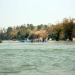 Monks riding on the Mekong