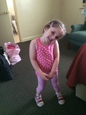 Modeling her new outfit in our room