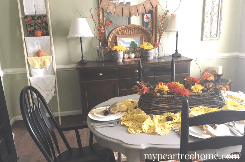 Want to create a warm, inviting place for your guests to enjoy this Thanksgiving? This tablescaoe and DIY place cards took less than 10 minutes to make! Click to the post for all of the details!