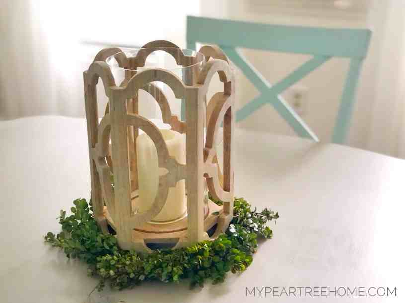 boxwood wreath used as a centerpiece for a candle-ring