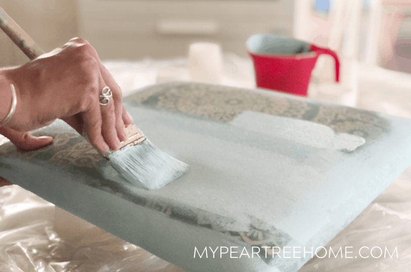 Easily learn how to paint chair cushions to get them looking like new again!