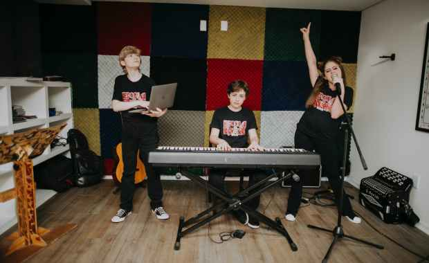 teenage musical group with instruments