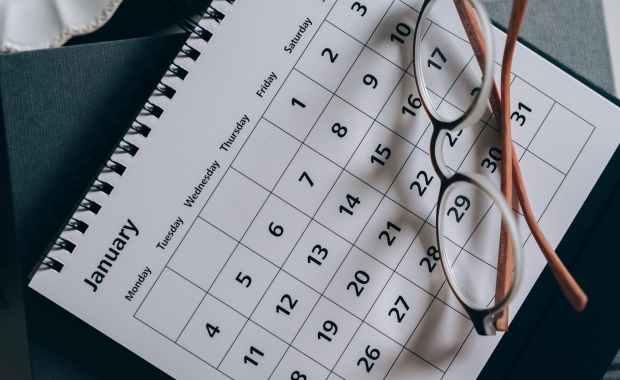 brown framed eyeglasses on a calendar