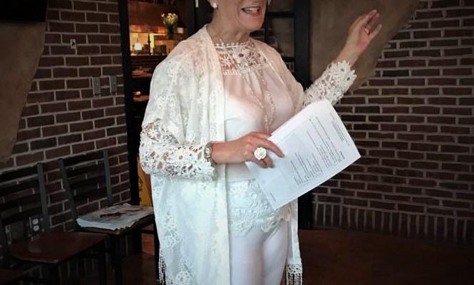 Nancy giving a PowerPoint training speech in a venue