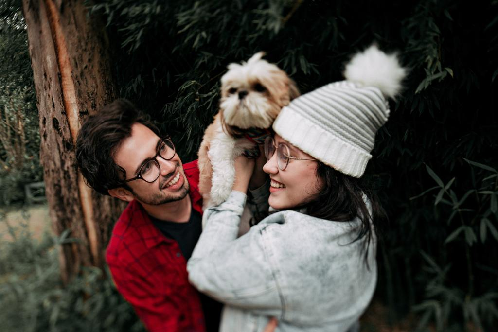 Image of a couple with a dog in the blog 11 Things to Remember Before You Adopt a Dog