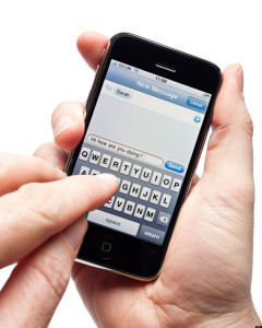 Male hands using iPhone writing a text message