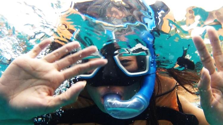 Michell Waving underwater