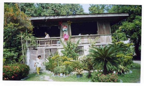 This looks to be a bahay na bata but a modest version