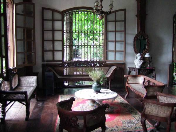 Balay Negrenese Museum (Gaston Ancestral Home), Silay. High ceilings, open windows, trees proving shade make this an inviting place on a hot afternoon.