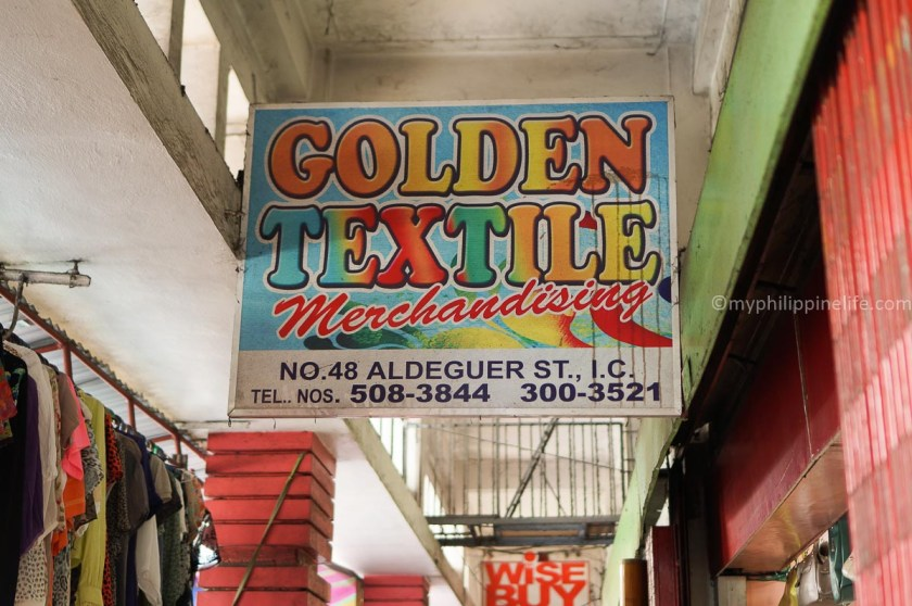 golden textile sign