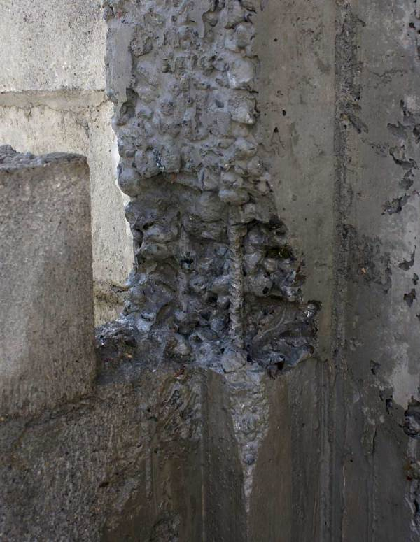 The effects of over vibration at the bottom of a column pour.