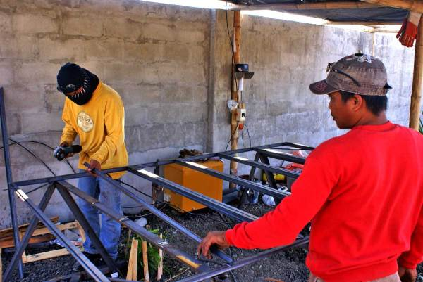Our welders beginning the fabrication of casement windows