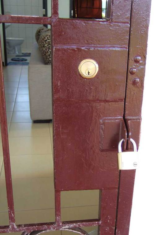 Security door locks from outside