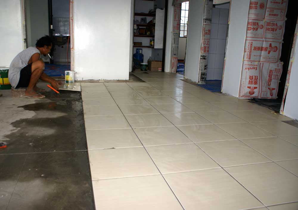 Setting tile in kitchen living room. Our Philippine House Project   Tiling   My Philippine Life