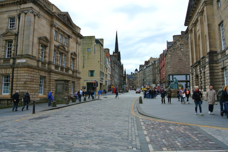 A cobbled street and old buildings in Edinburgh Scotland.