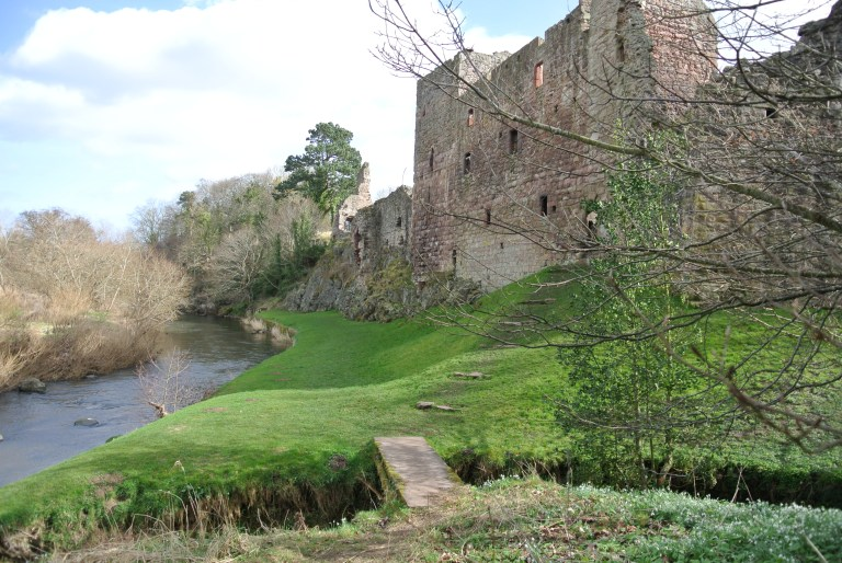A castle ruin on the banks of the River Tyne.