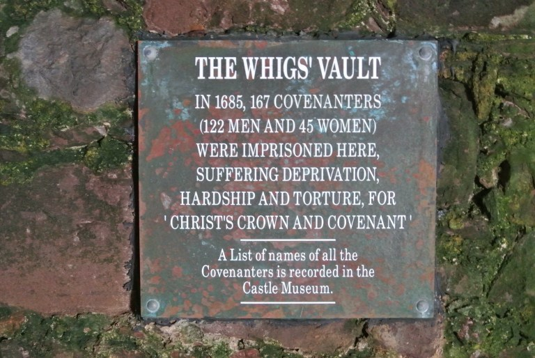 A sign for The Whig's Vault at Dunnottar Castle.