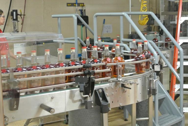 Maker's Mark bottles on a conveyer belt.