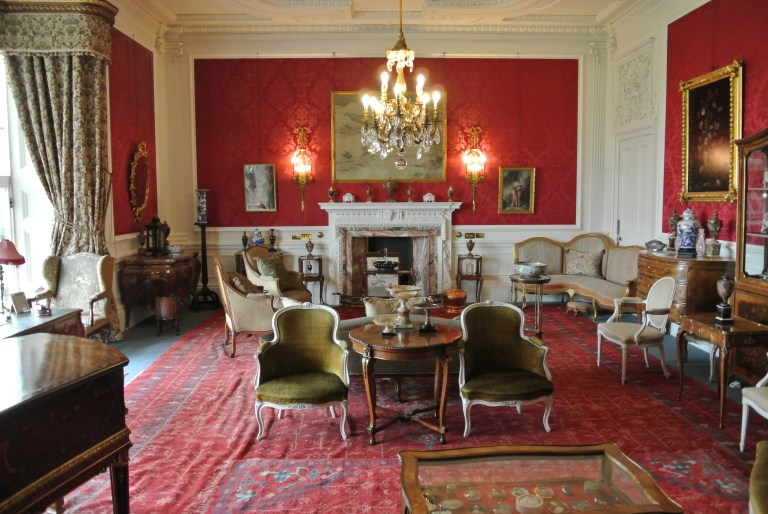 A red sitting room full of antique furniture at Lauriston Castle.