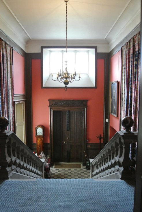 The main castle doors and a grand staircase at Lauriston Castle.