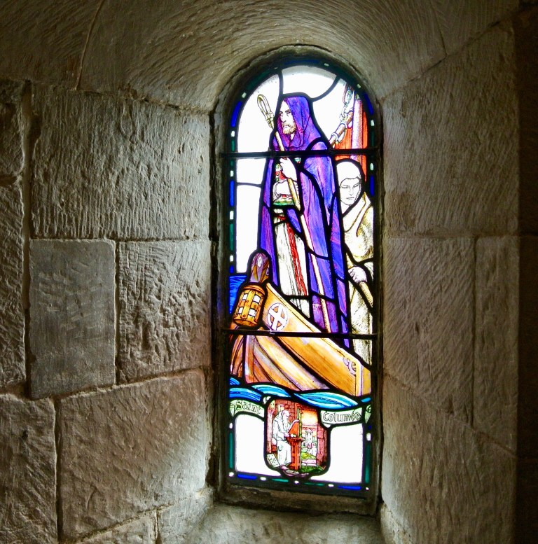 A stained glass window of St. Columba inside St. Margaret's Chapel.