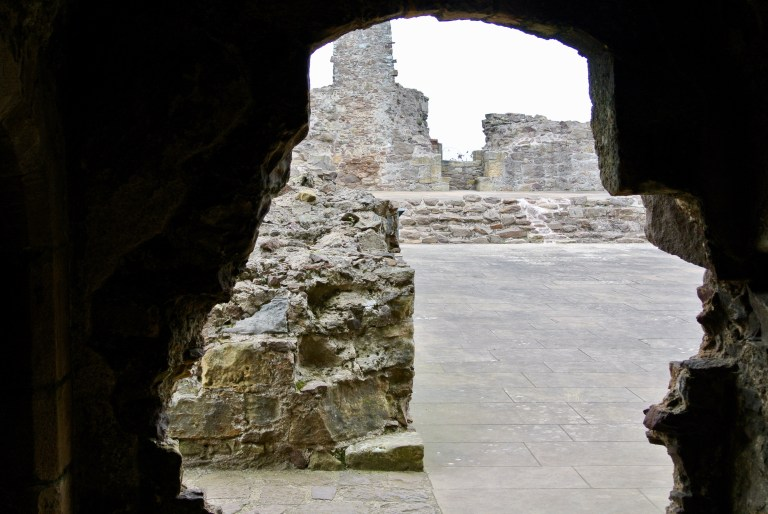 A jagged hole in the wall of Dirleton Castle.