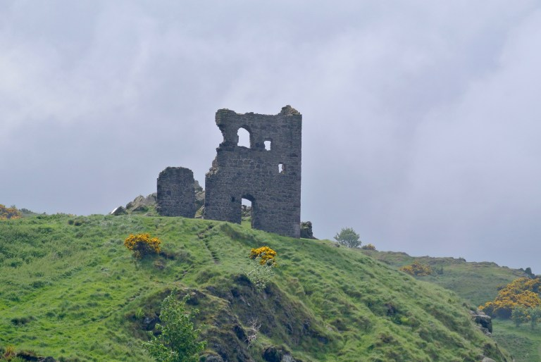 St. Anthony's Chapel ruin on a green hill in Holyrood Park.