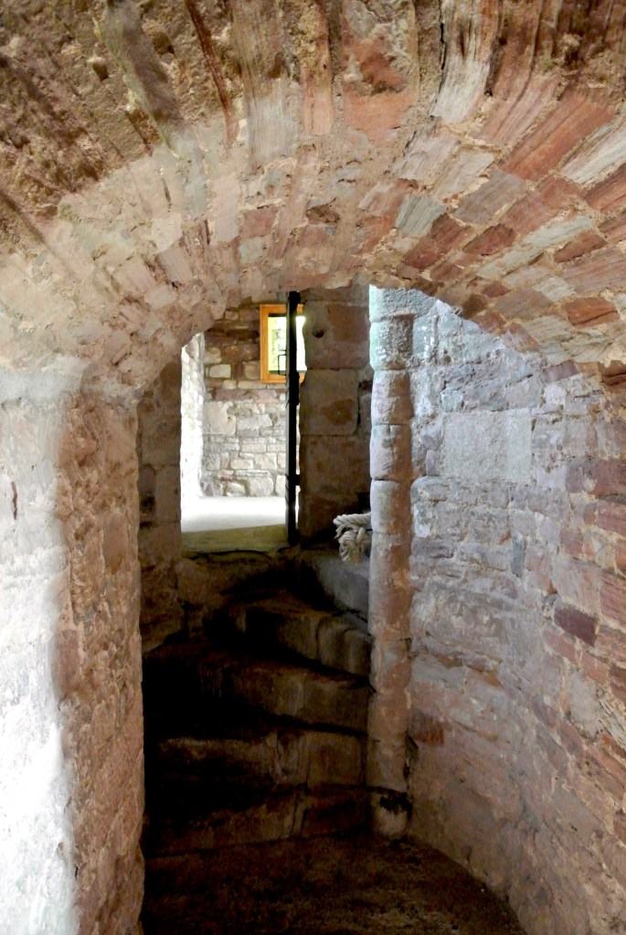 The entrance to a spiral castle staircase.
