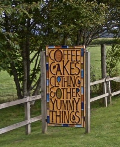 A sign for a coffee shop in Scotland.