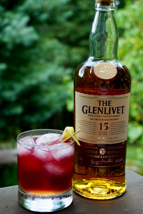 A Full Scottish cocktail next to a bottle of The Glenlivet 15.