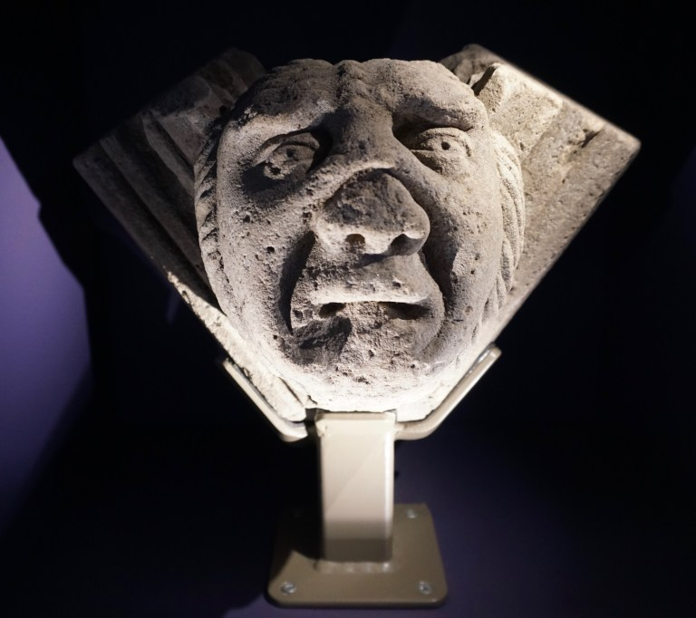 A stone carving of a face with an upset expression-a vault boss at Elgin Cathedral.
