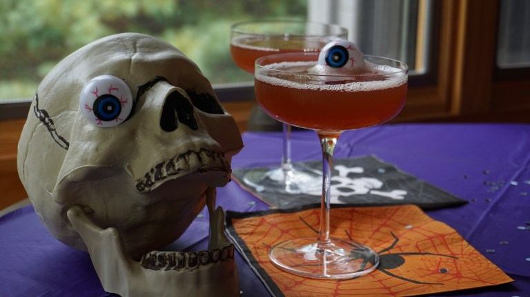 Professor's Poisoned Cocktail in a glass next to a plastic skull.
