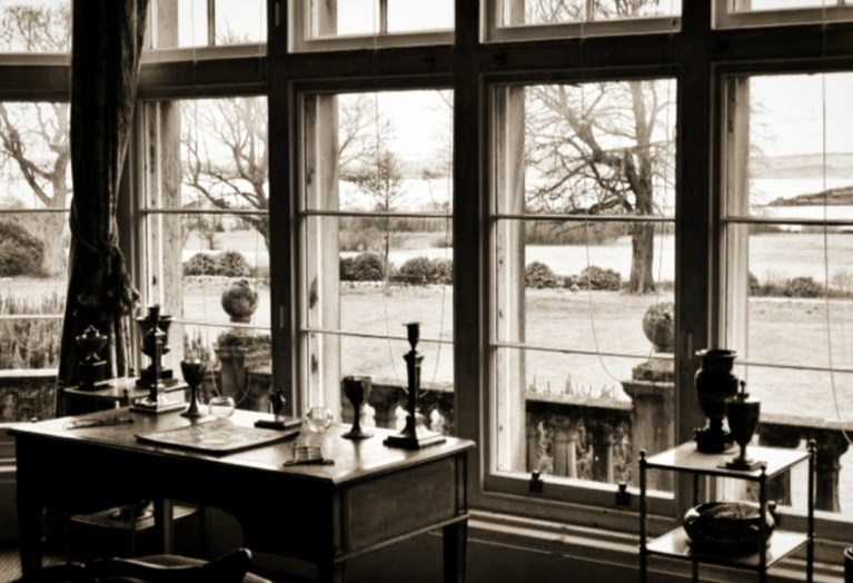 A desk in front of a large window, overlooking the Firth of Forth at Lauriston Castle.