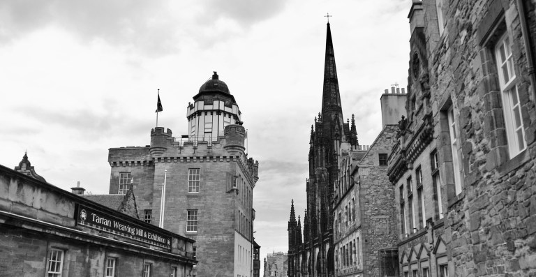 A black and white photo of the top of the Royal Mile in Edinburgh, Scotland.