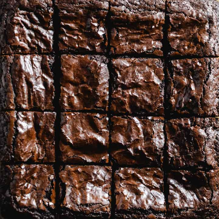 Close up of baked and cut brownie squares