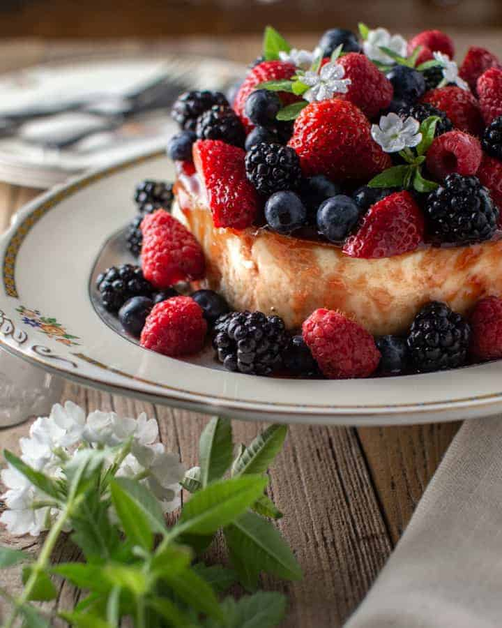 Summer berry cheesecake on antique platter