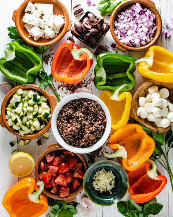 Raw ingredients for stuffed peppers laid out on a table in an overhead photo