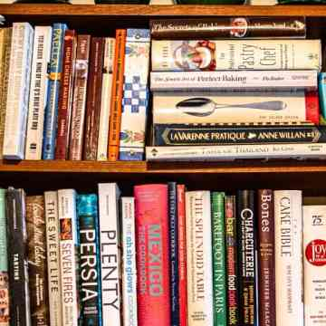 cookbooks on 2 shelves