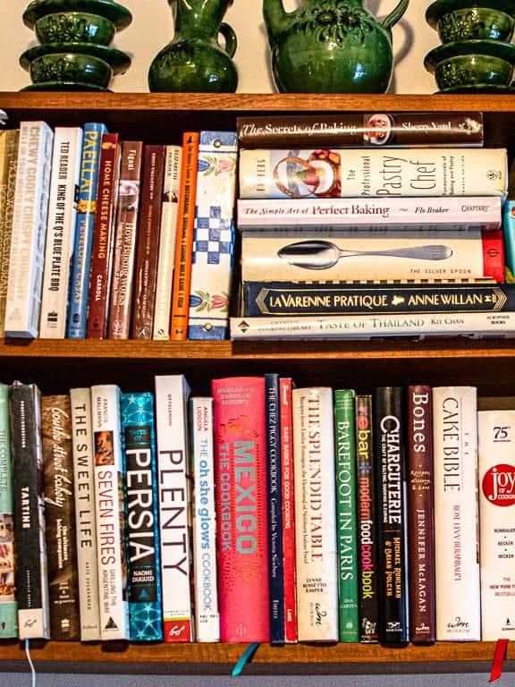 cookbooks on 2 shelves