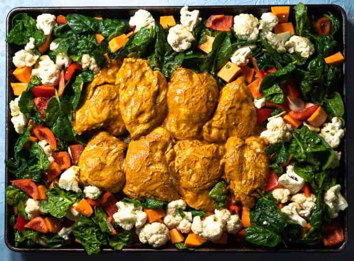 sheet pan curried chicken and vegetables on tray before baking