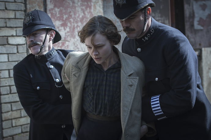 Carey Mulligan as Maud Watts struggle against police