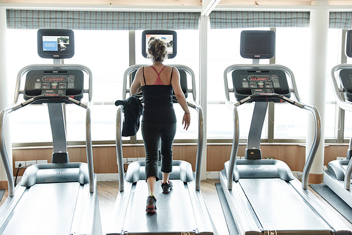 woman on treadmill - How not to gain weight on a cruise