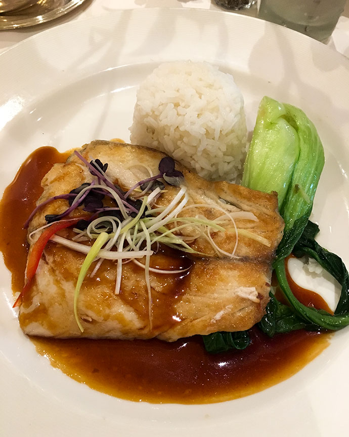 Grilled fish and rice dish