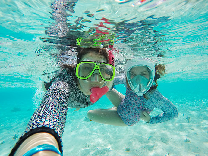 woman and girl underwater snorkelling