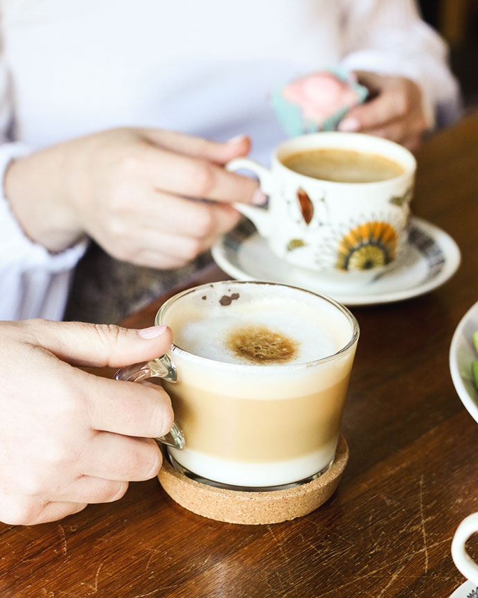 two hands holding coffee mugs - NESCAFÉ Dolce Gusto Esperta Coffee Machine review