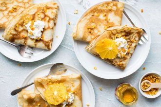 French crepe recipe - Crepes topped with orange slices and whipped cream